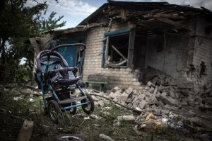 bombed home and baby carrige