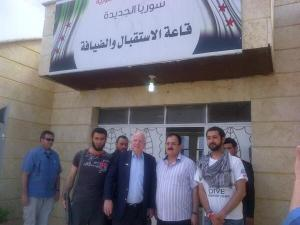 John McCain with FSA General Salem Idriss (right of McCain) and Al Qaeda leaders 2
